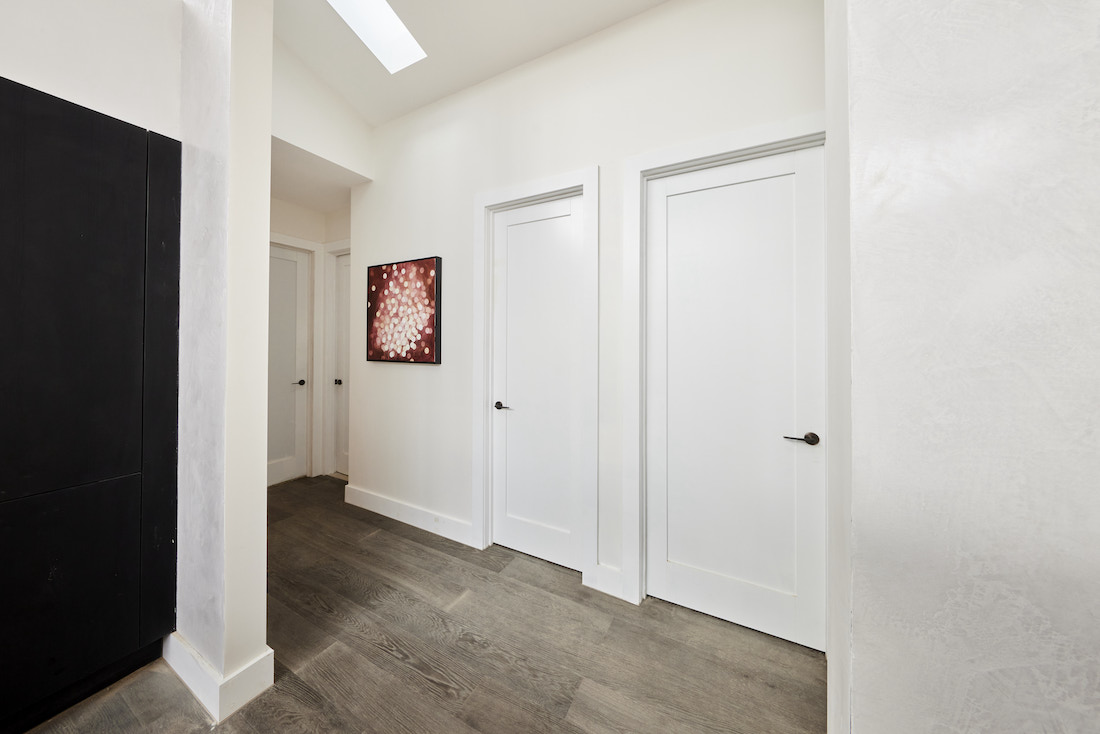 Simple hallway with ash timber floors