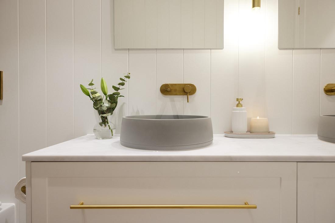 Round grey basin in bathroom