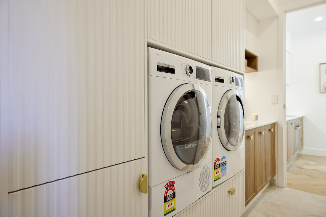 Panelled laundry cabinetry