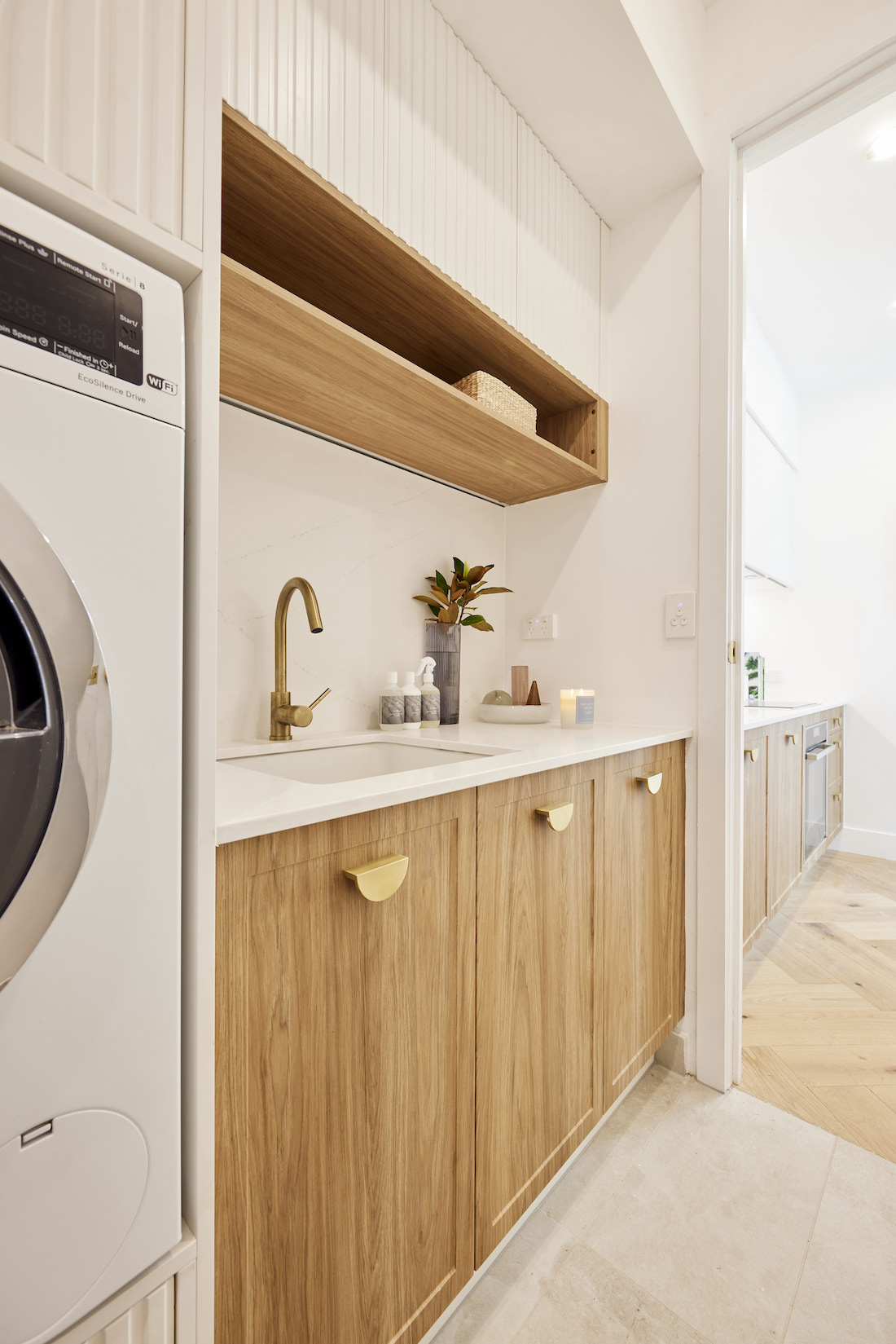 Laundry with timber cabinetry and open shelf