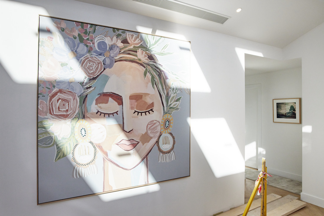 Large artwork above staircase