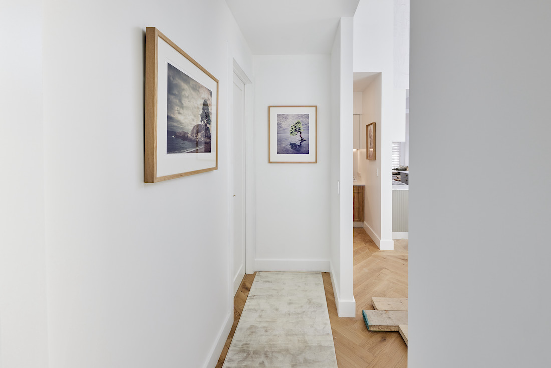 Hallway with runner and artwork