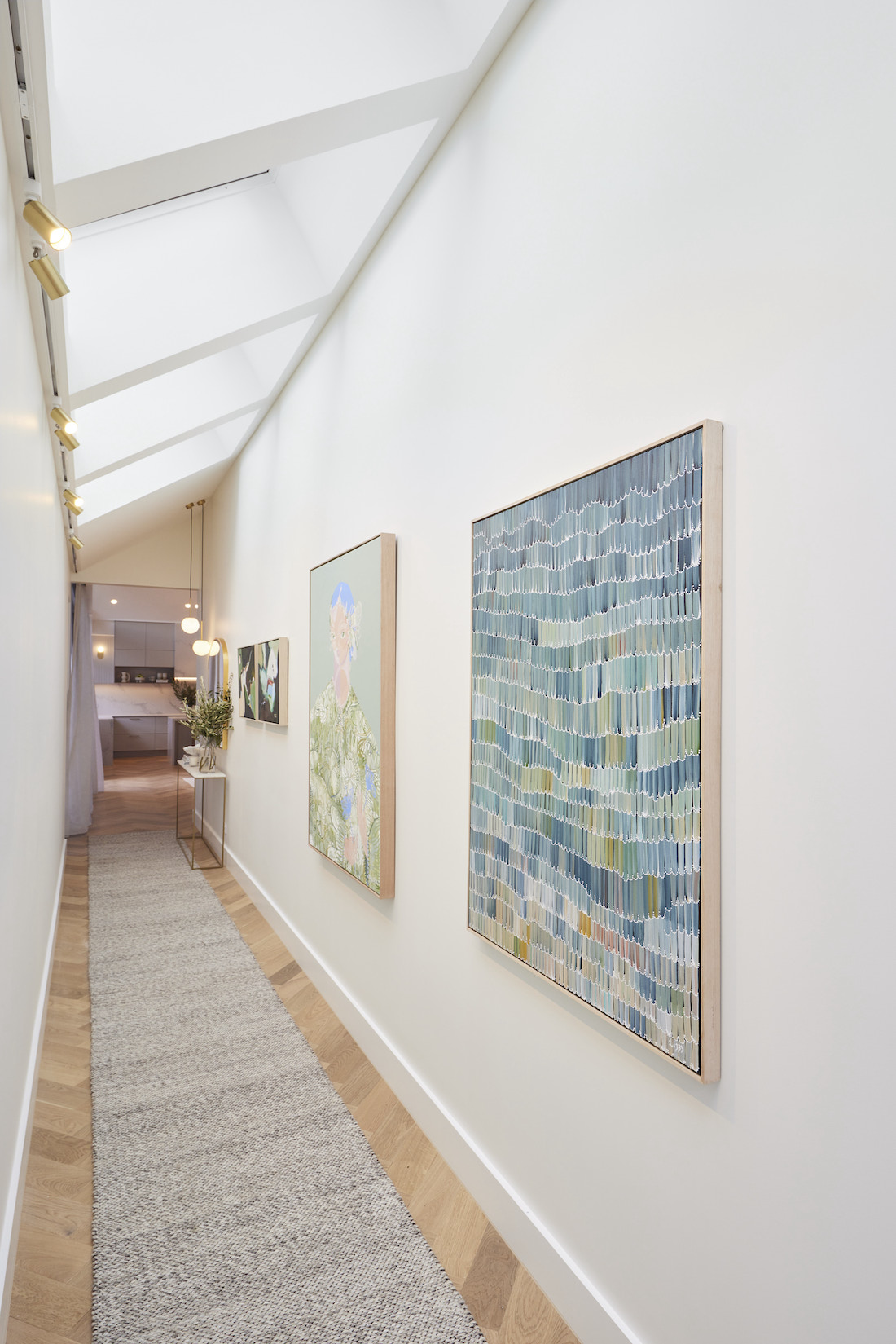 Skylight hallway with artwork