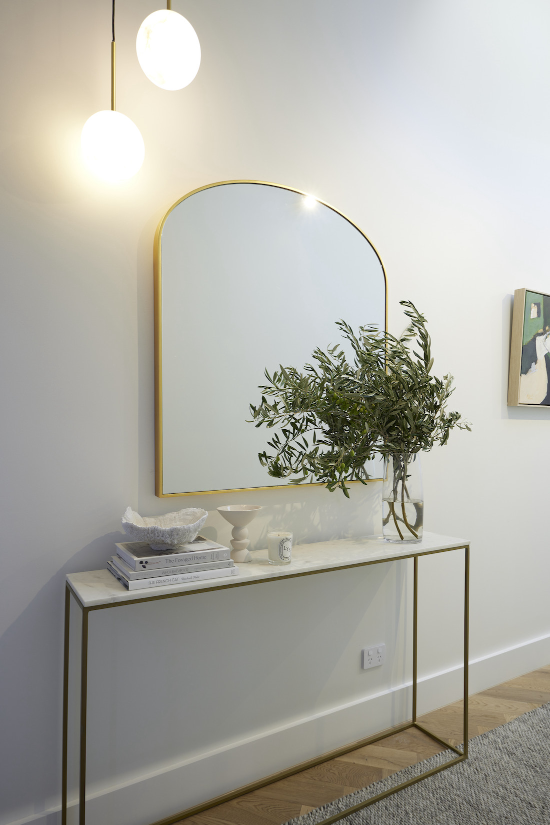 Arch mirror over hallway console table