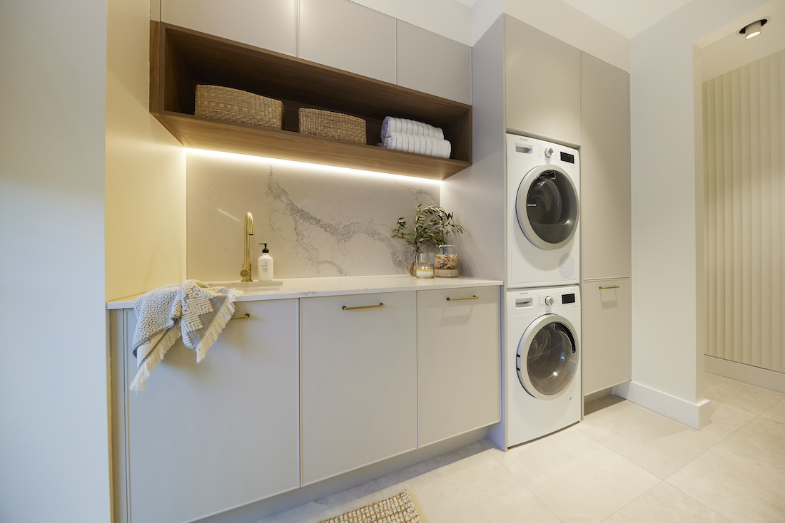 White and stone laundry with timber shelf