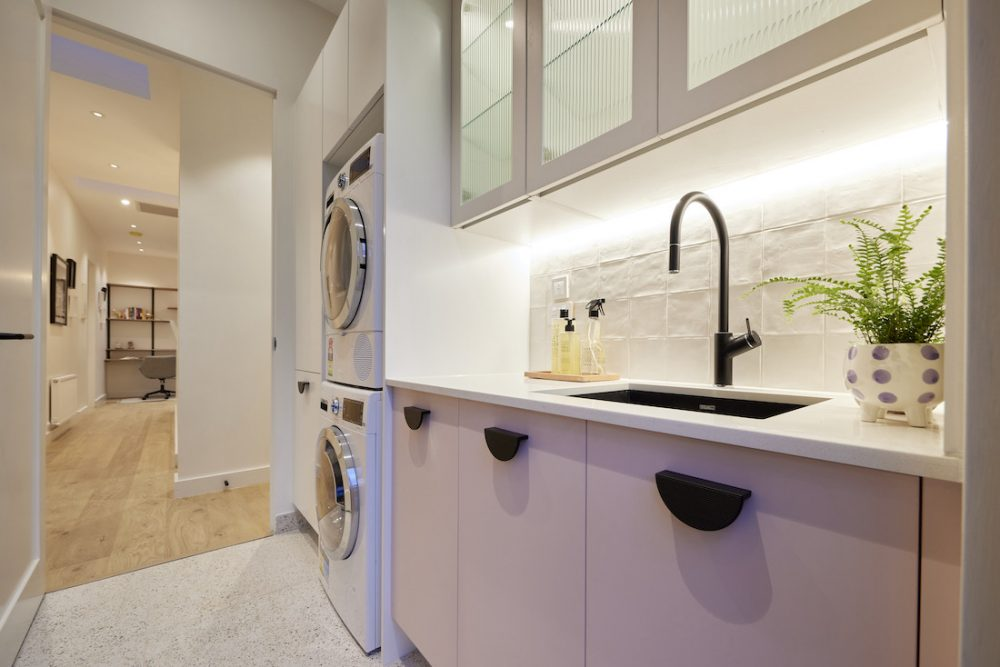 Pink cabinetry in laundry